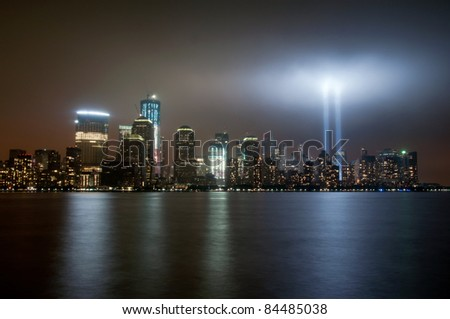 9/11 Tribute in Light memorial on September 11, 2011.  Taken from Exchange Place, Jersey City NJ - stock photo