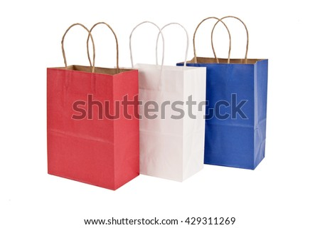 Triple Color Shopping Bags In Red White And Blue - stock photo