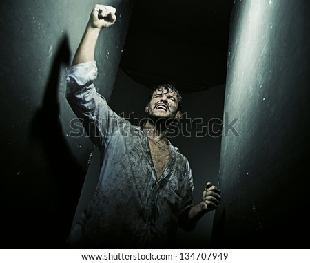 Triumphant man - stock photo