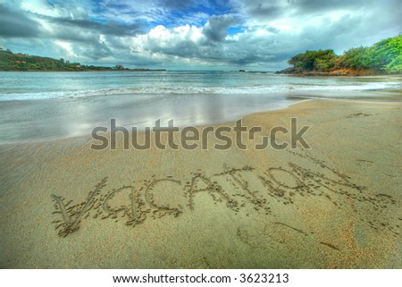 tropical beach - vacation sign - stock photo