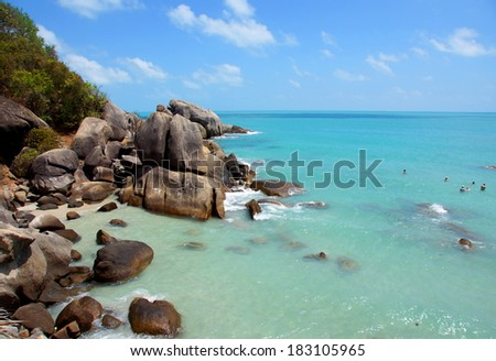 tropical ocean with a rocky coastline - stock photo