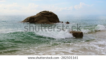 Tropical seascape with sea surf and stones on ocean coast, Lamai beach, Koh Samui, Thailand. - stock photo