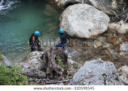 22.8.2015, Tscheppaschlucht, Austria, A river search and rescue team on duty in river pool under waterfall in National park - stock photo