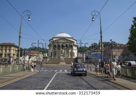 Turin, Italy, Europe - JUNE 28, 2015 . On the bridge over Po river.Far is the Gran Madre di Dio Church in Turin. - stock photo