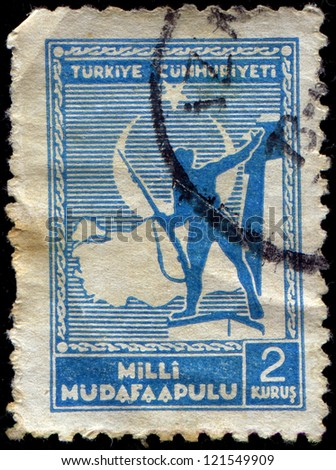 TURKEY- CIRCA 1941: A stamp printed in Turkey shows Soldier and Map of Turkey, circa 1941 - stock photo
