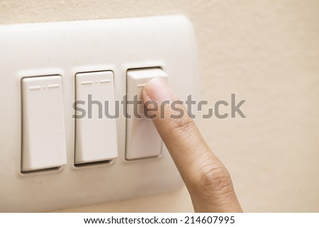 Turning Off Light Switch - stock photo