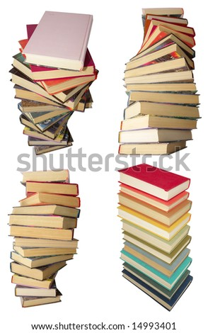 4 twirled piles of old books with color covers - stock photo