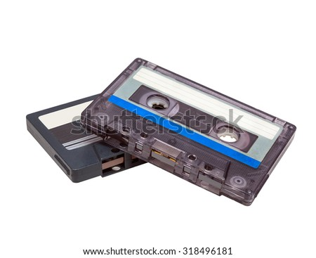 two audio cassettes close-up on a white background. sound recording and music. obsolete isolated - stock photo