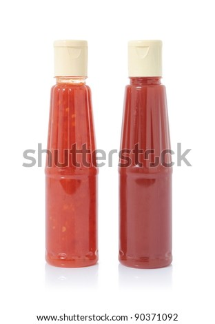 two bottles of sauce isolated on white background - stock photo