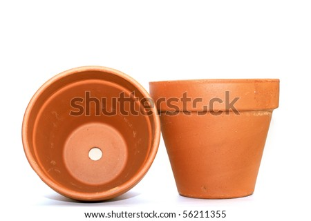 two clay flower pots over white background - stock photo