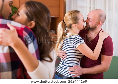Two couples  moving in slow dance at home