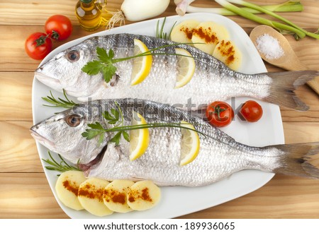 Two fish ready for baking - stock photo