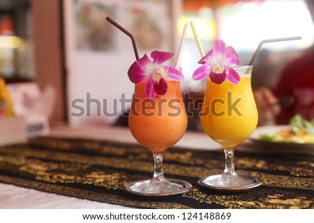 two fresh juiceson the beach on the table - stock photo