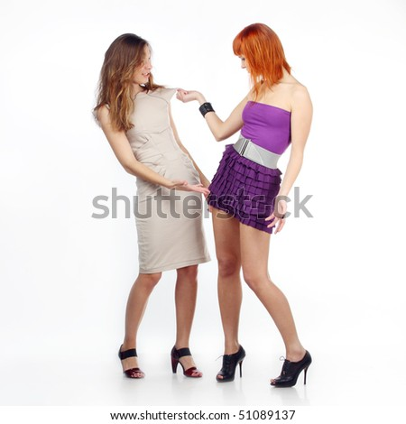 Two girlfriends discuss clothes. Girlfriends are dissatisfied with clothes each other