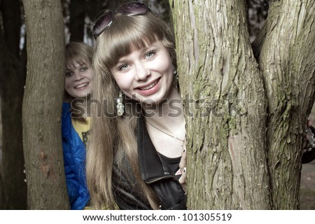 Two girls in wood - stock photo