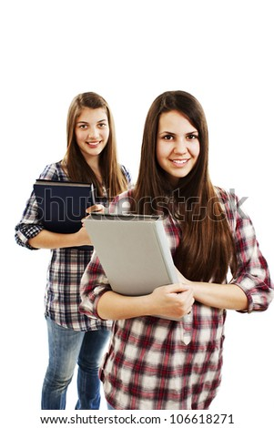 Two girls students on a white background - stock photo