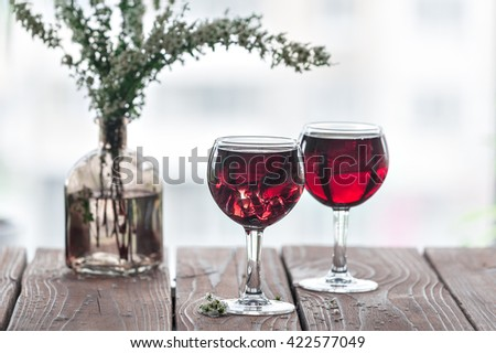 Two Glasses of red wine on wooden background - stock photo