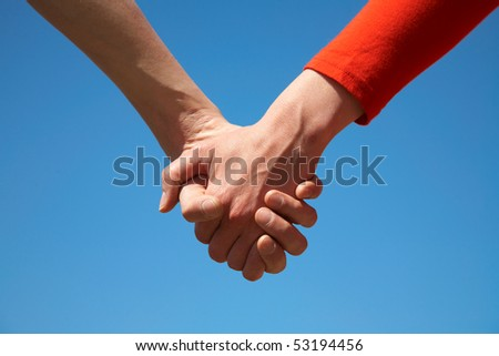 two hands now involved with the blue sky - stock photo
