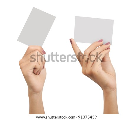 two hands of a woman carrying a blank card isolated on white background - stock photo