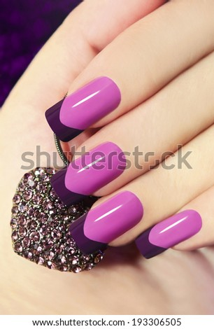 Two-tone French manicure pink and purple with decoration in the form of heart  - stock photo