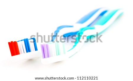 Two toothbrushes.