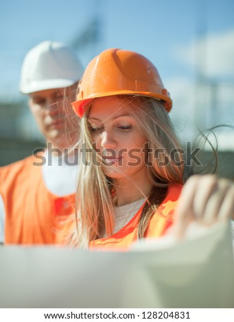 two workers wearing protective helmet works at electrical power station - stock photo