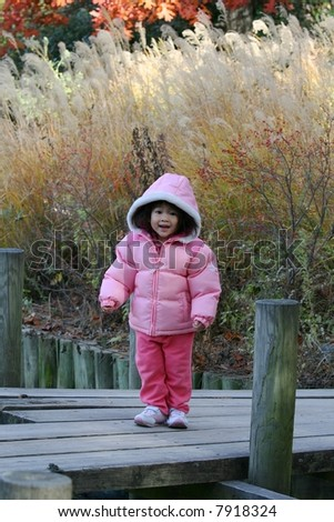 two-year-old girl at park - stock photo