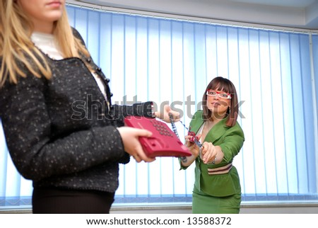 .two young and beautiful businesswoman with red phone