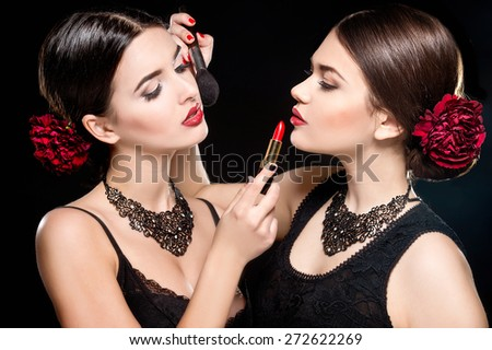 Two young beautiful women with stylish make-up and red lips. Spanish women - stock photo