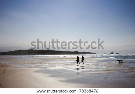 Two young girls wllking at the sea - stock photo