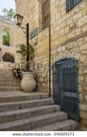 Typical street alley in Safed's old city with stone walls and blue coloured doors.Since the 16th century, Safed has been considered one of Judaism's Four Holy Cities,