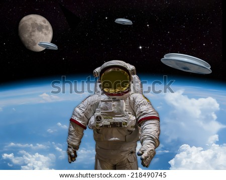 3 UFOs entering the earths atmosphere with the moon visible in the distance. An Astronaut in foreground. Welcome our new overlords! - Artist Impression - stock photo