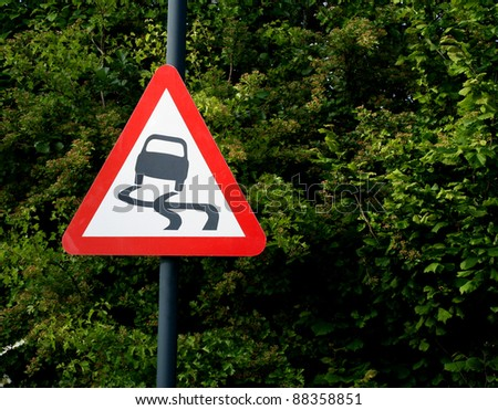 UK danger of swerving road sign - stock photo