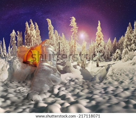 ukraine panoramic view of wild forest in the mountains of Ukrainian Carpathians, in the vacation village of Osmoloda. Blizzard rolled in a very deep layer of snow Tent nestled protective wall of snow - stock photo