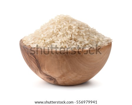 Uncooked dry rice in wooden bowl isolated on white