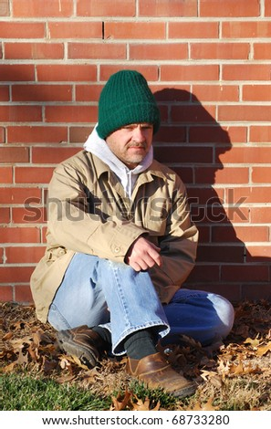 unemployed middle age homeless man - stock photo
