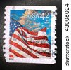 UNITED STATES OF AMERICA - CIRCA 2008: A stamp printed in the United States of America shows image of the US flag and clouds during the day, series, circa 2008 - stock photo