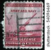 UNITED STATES OF AMERICA - CIRCA 1940: A stamp printed in the USA shows 90-millimeter anti-aircraft gun, circa 1940 - stock photo