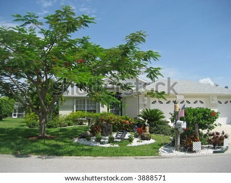 Upscale Tropical Rancher with Lovely Landscaping - stock photo