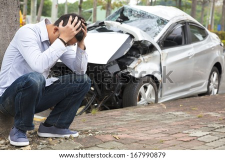 Upset driver After Traffic Accident - stock photo
