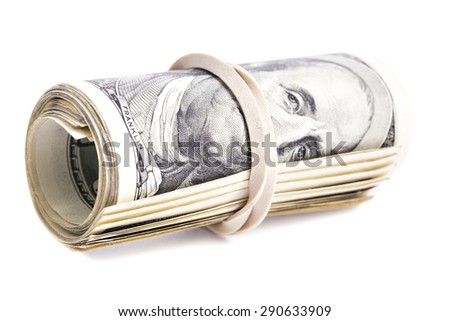 100 US dollars banknotes rolled up and tightened with rubber band isolated on white background