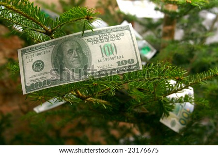 100 US dolllars and other banknotes on a christmas tree - stock photo