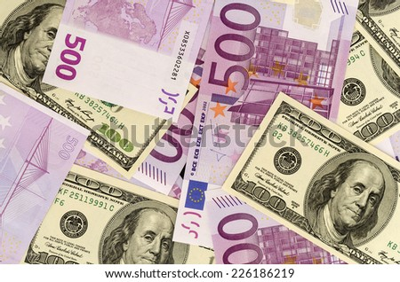 100 Usd and 500 Euro banknotes - stock photo