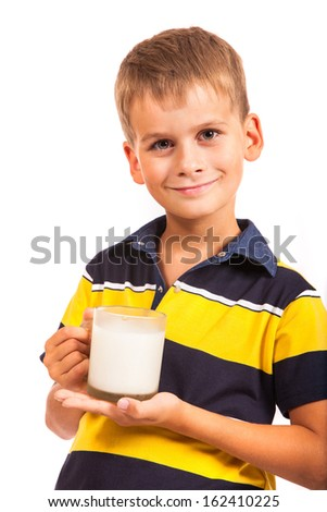 Ã?Â??ute boy is drinking milk. Schoolboy is holding a cup of milk isolated on a white background - stock photo