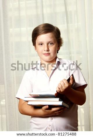 ?ute boy with books - stock photo