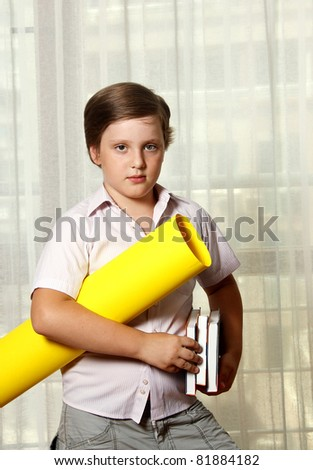 ?ute boy with books and roll - stock photo