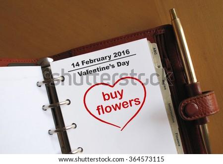 Valentine's Day reminder in an organiser                                  - stock photo