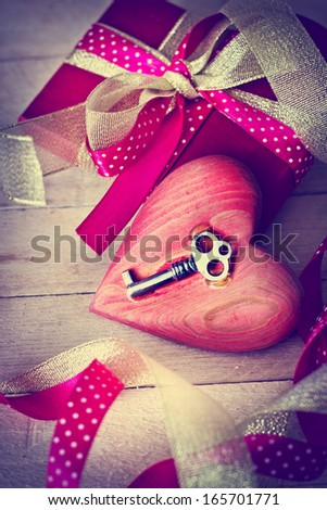 Valentines Day gift box and heart with key as a symbol of love. Vintage holiday background. - stock photo