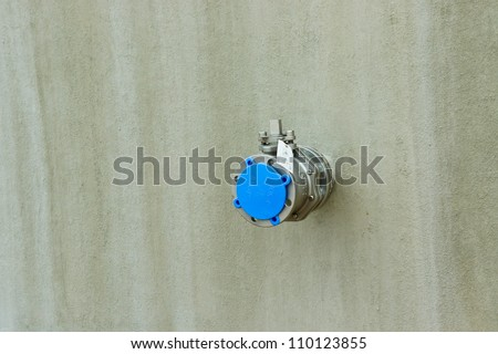 valves on a wall - stock photo