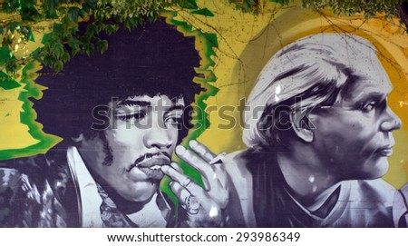 VANCOUVER BC CANADA JUNE 7 2015: Mural of Jimi Hendrix (born Johnny Allen Hendrix; November 27, 1942 â?? September 18, 1970) was an American guitarist, singer, and songwriter.  - stock photo